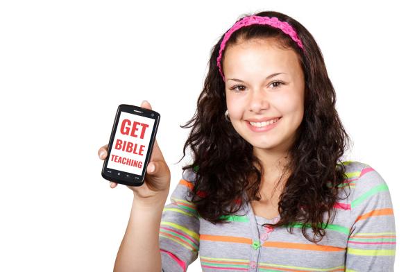 teenage_girl_holding_mobile_device